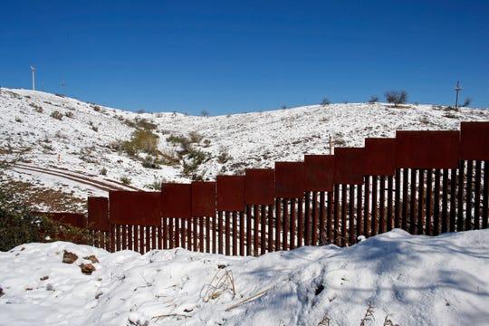 Border wall between Nogales, Ariz (top) and Nogales, Mexico on Feb. 23, 2019.