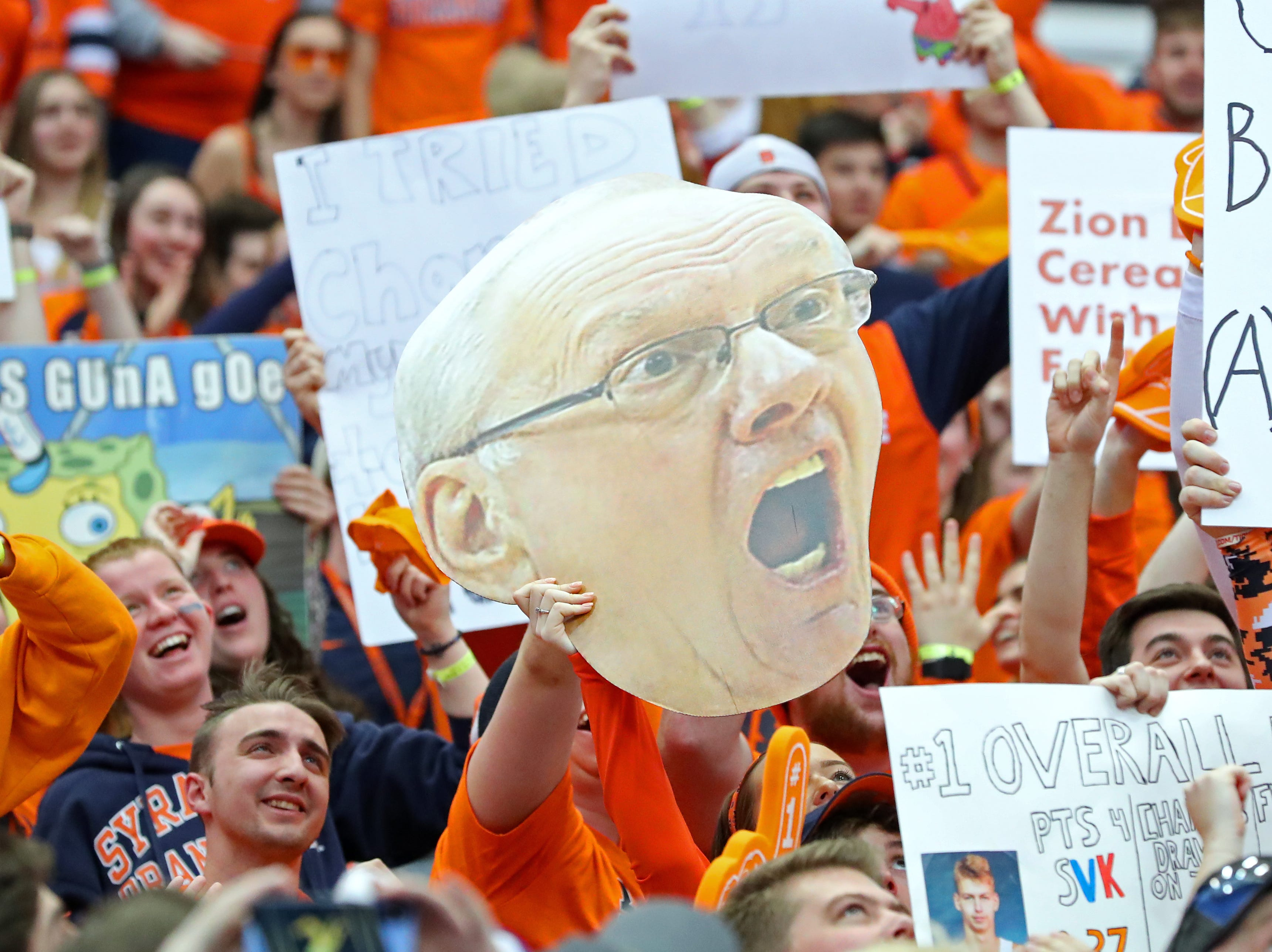 A Syracuse fan holds a cut-out poster of head coach Jim Boeheim before the game against Duke.