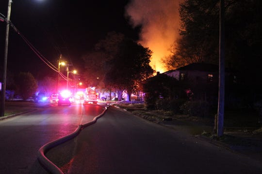 Alexandria firefighters battle a house fire on Polk Street Sunday night. While the cause of that fire remains under investigation, the department already has investigated 10 arson fires in the city in 2019.