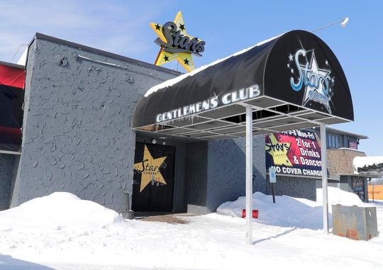 """Stars Cabaret gentleman's club on Monday, February 25, 2019, in Neenah Wis. The club was used to provided shelter after one person was killed and dozens of drivers were stranded following a pileup of more than 100 cars on Interstate 41 on Sunday, February 24, 2019. The """"chain reaction crash"""" occurred during whiteout conditions at 11:10 a.m."""