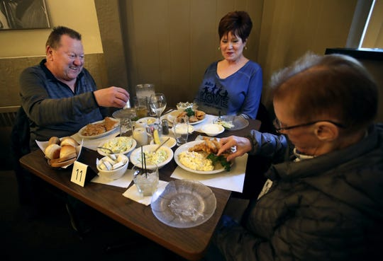 Larry and Kathy Burklund, of Green Bay, have a fish fry dinner with friend Julie Adams, also of Green Bay, at Van Abel's of Hollandtown.