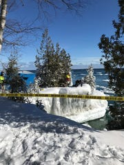 A warden from the Wisconsin Department of Natural Resources deploys an underwater drone to search for Eric Richter of Neenah at Cave Point County Park in Door County. Richter was taking photographs at the park on Feb. 10 when he went missing.