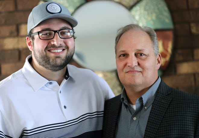 """Trace Sonnleitner, left, left college to take care of his father Kurt, who had been diagnosed with a rare type of blood cancer, known as multiple myeloma. That's when he picked up a notebook and started to write. With his father in remission, Trace, 25, turned his writing into a novel, """"Jane Grace: Library of Light,"""" which was published last year."""