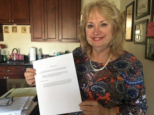 Longtime Hazlet resident and former township council  member Barbara Ronchetti holds up a petition to change the way the mayor is decided.
