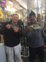 Ricky White and David Ruff from Philadelphia with some Toms River white perch at Murphy's Hook House.