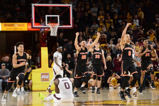 Arizona State Sun Devils guard Luguentz Dort (0) reacts as Princeton Tigers players celebrate after the game at Wells Fargo Arena (AZ).