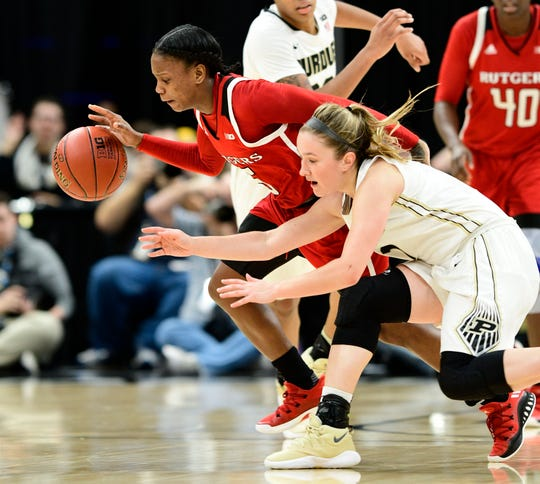 Mar 1, 2018; Indianapolis, IN, USA; Rutgers Scarlet Knights guard Ciani Cryor (5) steals the ball away from Purdue Boilermakers guard Karissa McLaughlin (1) during the second round of the Big Ten Conference Tournament at Bankers Life Fieldhouse. Rutgers defeated Purdue 62-60. Mandatory Credit: Marc Lebryk-USA TODAY Sports