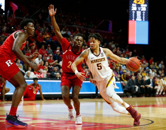 Minnesota Golden Gophers guard Amir Coffey (5) drives to the basket against Rutgers Scarlet Knights guard Montez Mathis (23) during the first half at Rutgers Athletic Center (RAC).