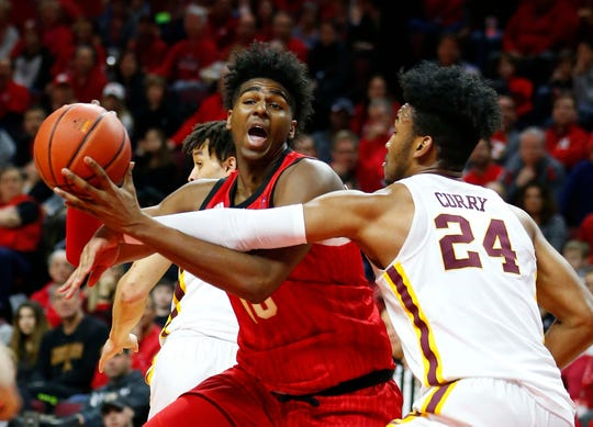 Rutgers Scarlet Knights center Myles Johnson (15) drives to the basket against Minnesota Golden Gophers forward Eric Curry (24) during the first half at Rutgers Athletic Center (RAC).