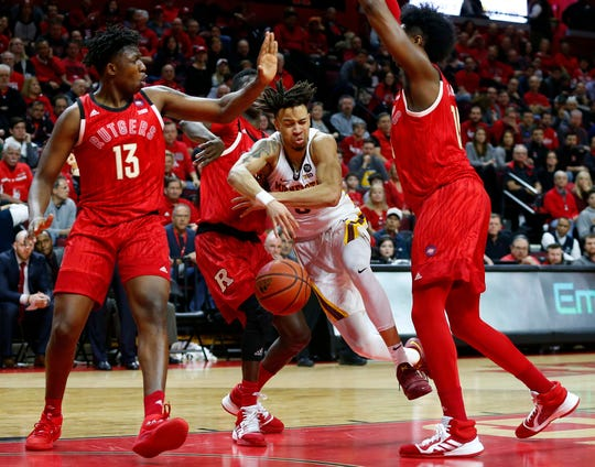 Rutgers Scarlet Knights forward Shaq Carter (13) defends against Minnesota Golden Gophers guard Amir Coffey (5)