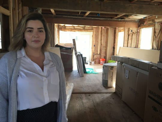 Stephanie Pontes stands inside the Middletown home she purchased last year. The township halted construction in October.