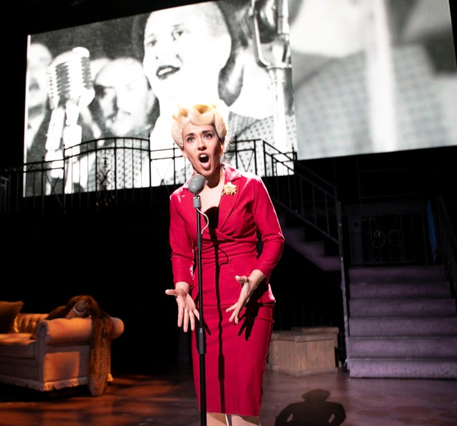 "Eva Peron (Yael Reich) goes on the radio to exhort her followers to take action in this scene from ""Evita."""