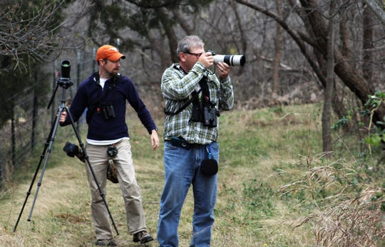 Jay Packer, left, pauses while David Sarkozi takes a photo in northeast Abilene during his visit to Abilene in early February.