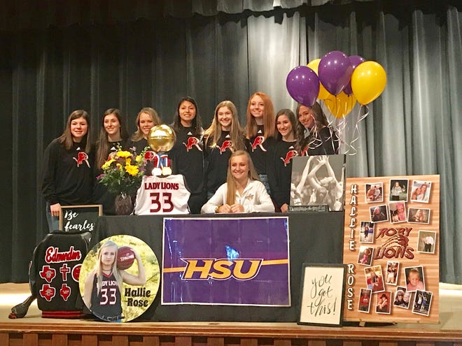 Roby senior Hallie Rose Edmondson, seated, is surrounded by teammates during a signing ceremony Monday, Feb. 25, 2019, at Roby High School.