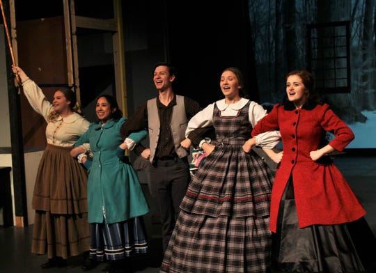 "Madeline Lowry, right, as Jo March joins her sisters and Laurie in a singing number in Hardin-Simmons' ""Little Women: A Musical."""
