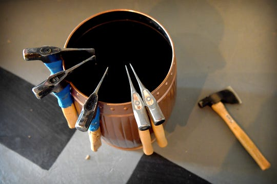 Hatchets are ready to be thrown at wooden targets at Axeville Throwing Club, Asheville's first ax throwing facility, which is planning to open to the public in March.