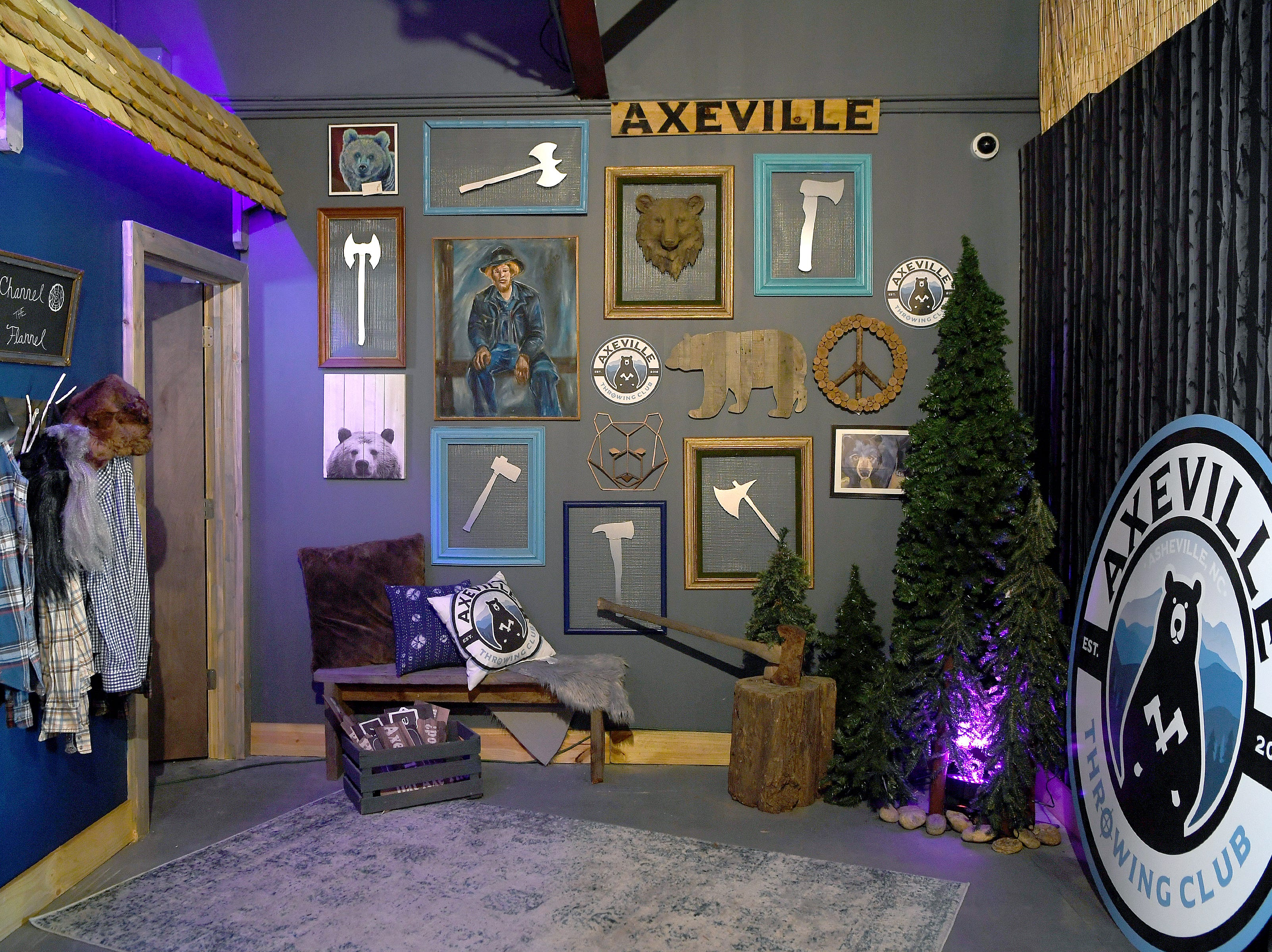 A photo-taking area at Axeville Throwing Club, Asheville's first ax throwing facility, adds to the overall vibe of the club which is planning to open to the public in March.