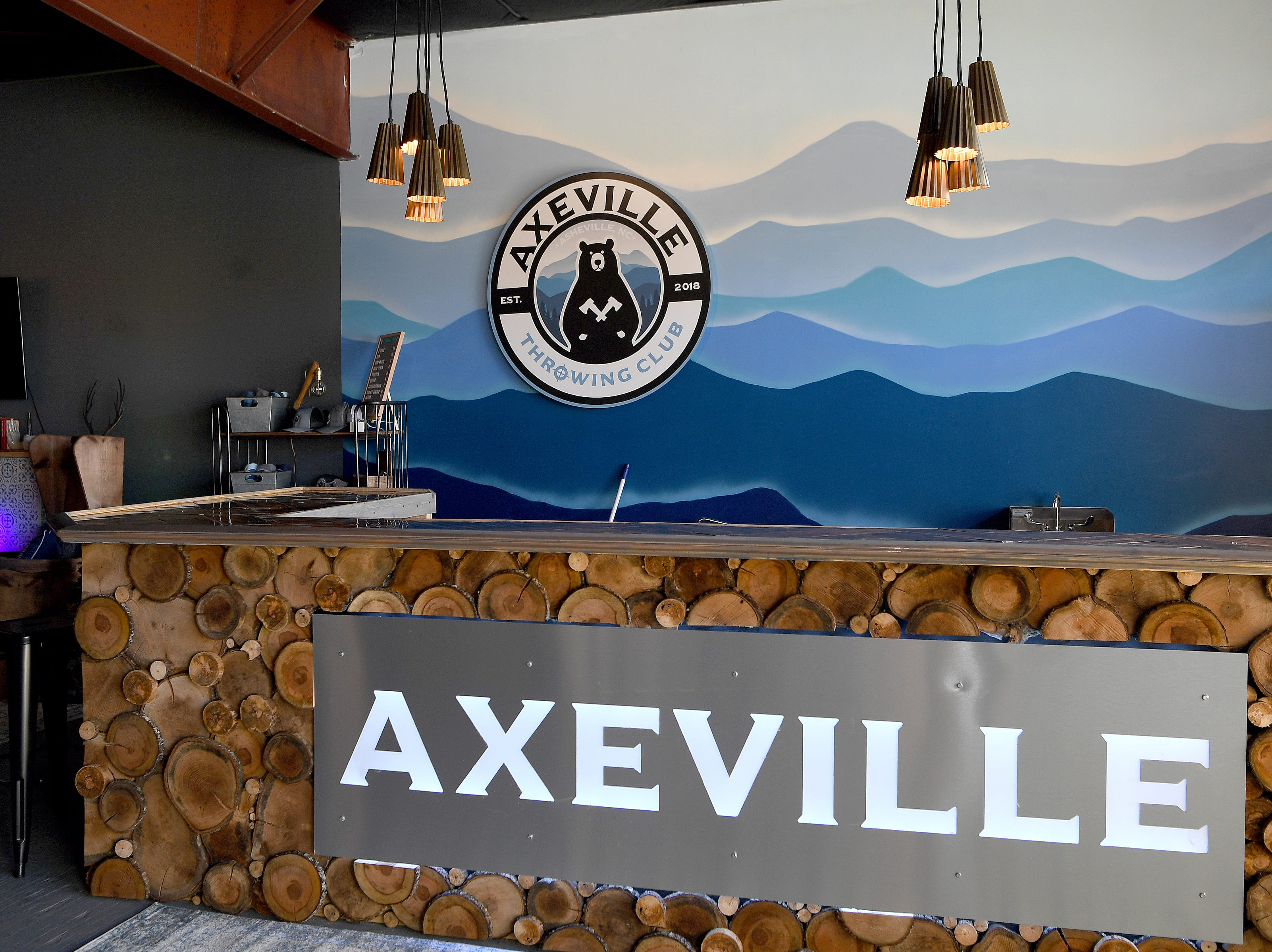 Axeville Throwing Club, Asheville's first ax throwing facility, is planning to open to the public in March. The facility serves beer, cider and wine but drinking is not the main attraction of the facility.