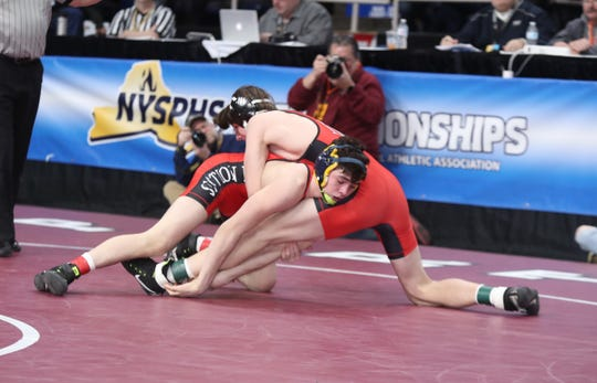 BGAH's Brody Oleksak wrestles Tioga's John Worthing in the 138-pound match of the semifinal round of NYSPHSAA wrestling championship at The Times Union Center in Albany on Saturday.
