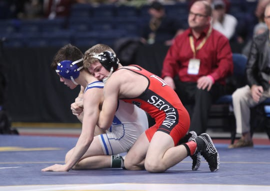 Norwich's Dante Geislinger wrestles Caleb Svingala from Maple Hill in the 106-pound final match of the NYSPHSAA championships at the The Times Union Center in Albany on Saturday, February 23, 2019.