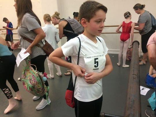 Richard Huxtable attaches his number for American Ballet Theatre's Youth Summer Intensive program.