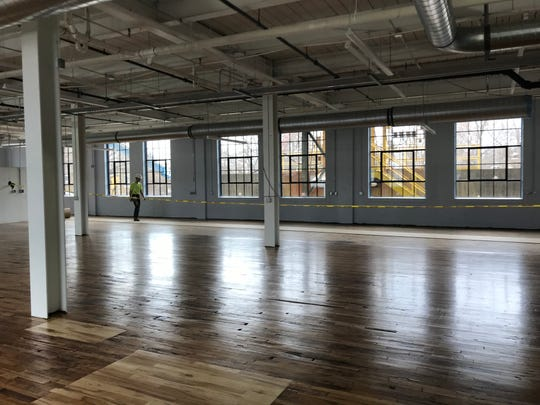 Original hardwood floors, and historically replaced windows  in the ground floor commercial space at 6 Emma Street.