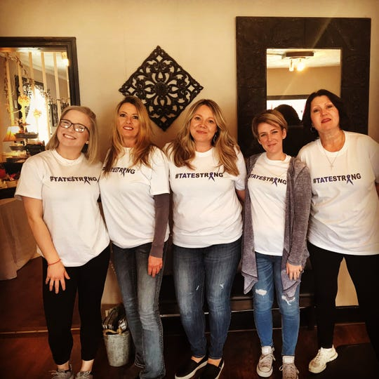 Left to right: Hannah Quinn, Mary Jane Banks, Sparrow Salon owner April Tweed, Mindy Stafford and Debbie Leon participated in a cut-a-thon on Feb. 18, raising money for local man Tate Brown.