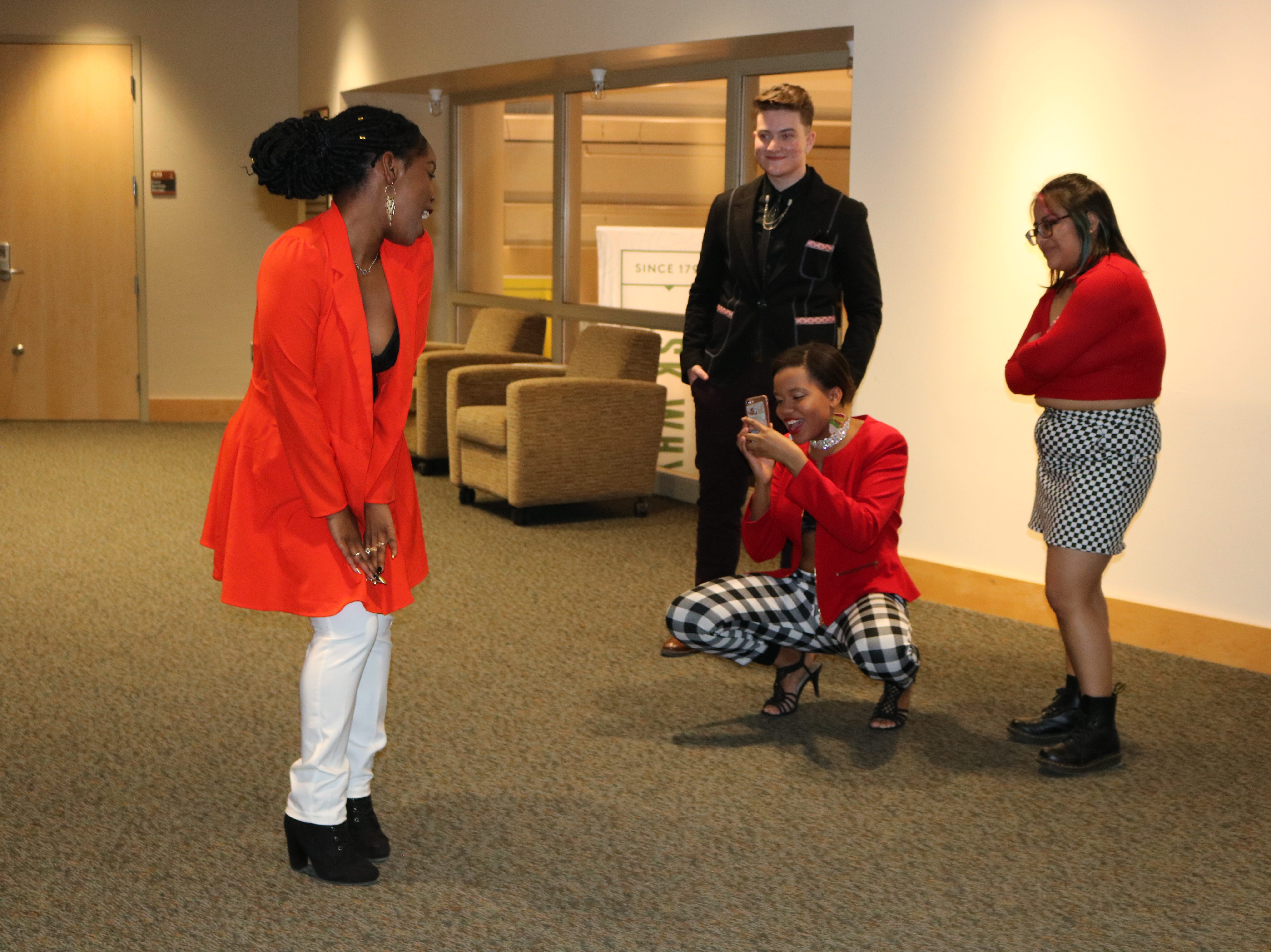Champlain College students pose during intermission at UVM's annual fashion show on Sat., Feb. 23, 2019.