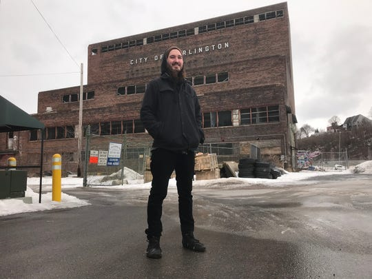 Tim Novine, a 2013 UVM grad in Community Development, stands outside the Moran Plant in Burlington on Monday, Feb. 25, 2019.