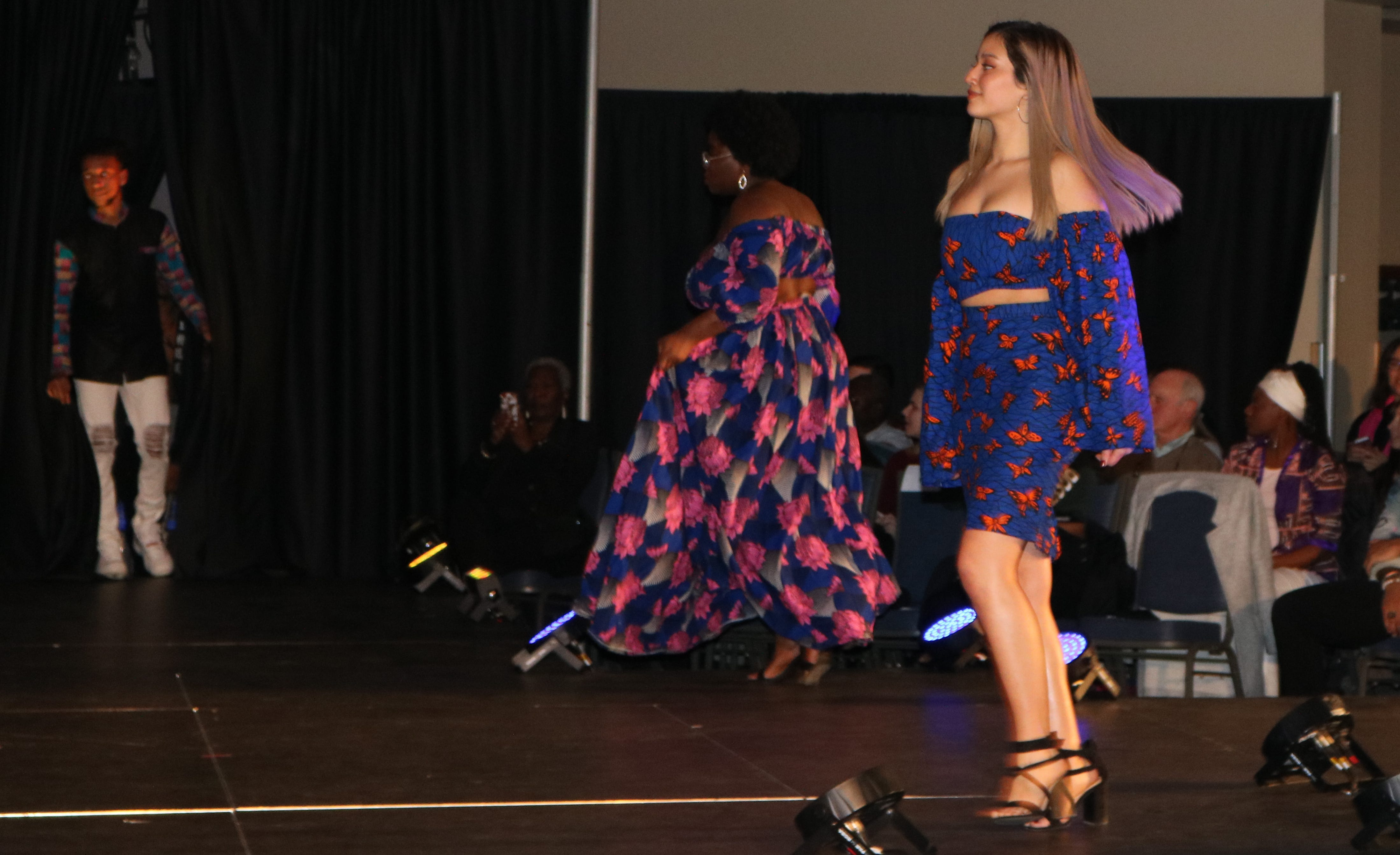 """African prints cut for contemporary lounge and club wear got shouts from the crowd at the 2019 fashion show, """"Paint it Black,"""" at the Davis Center on Saturday, Feb. 23, 2019."""
