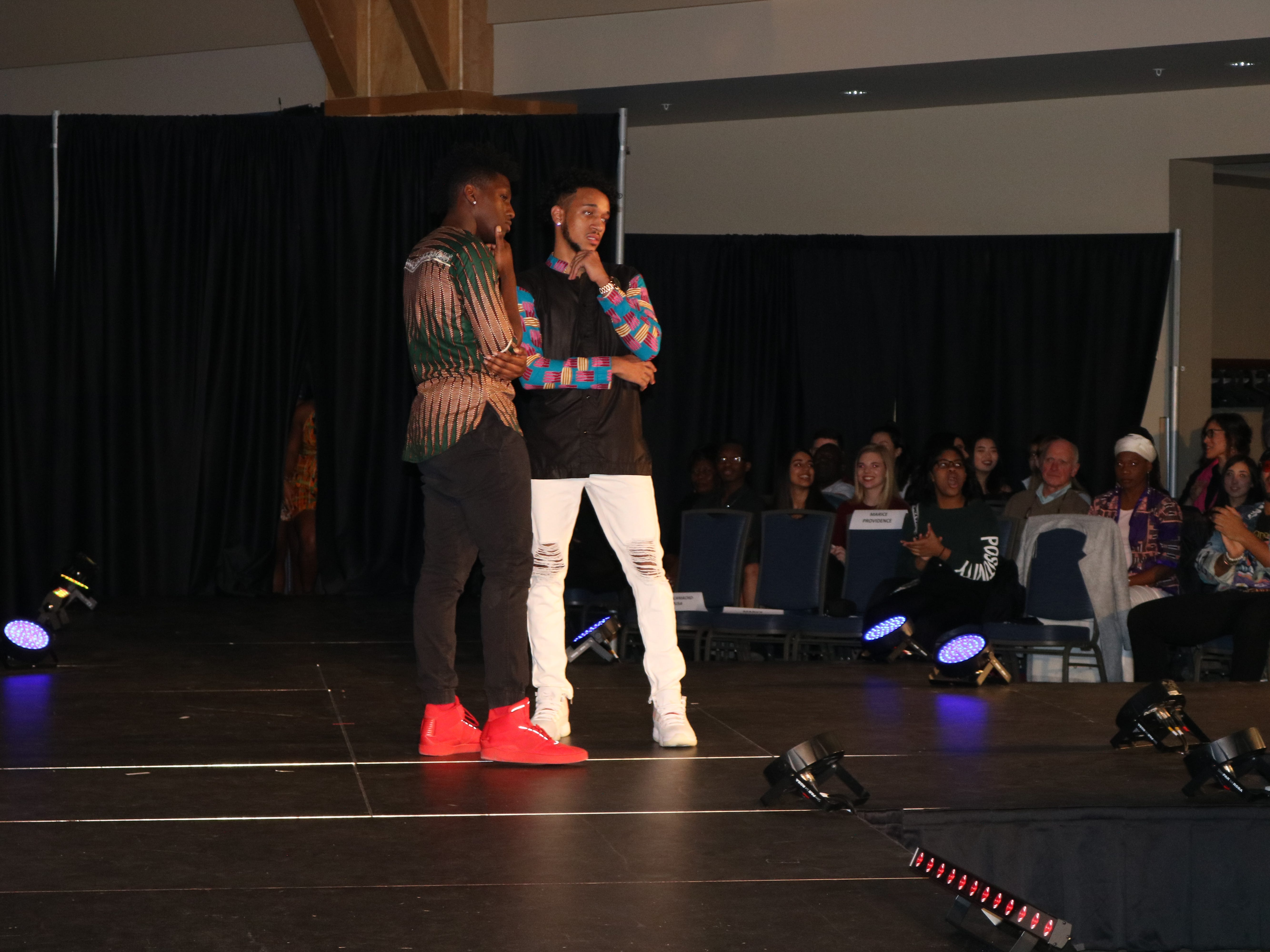 """Models pose in scenes created by coaches, who help create a dynamic show for viewers at UVM's 2019 fashion show, """"Paint it Black,"""" on Sat. Feb. 23, 2019."""