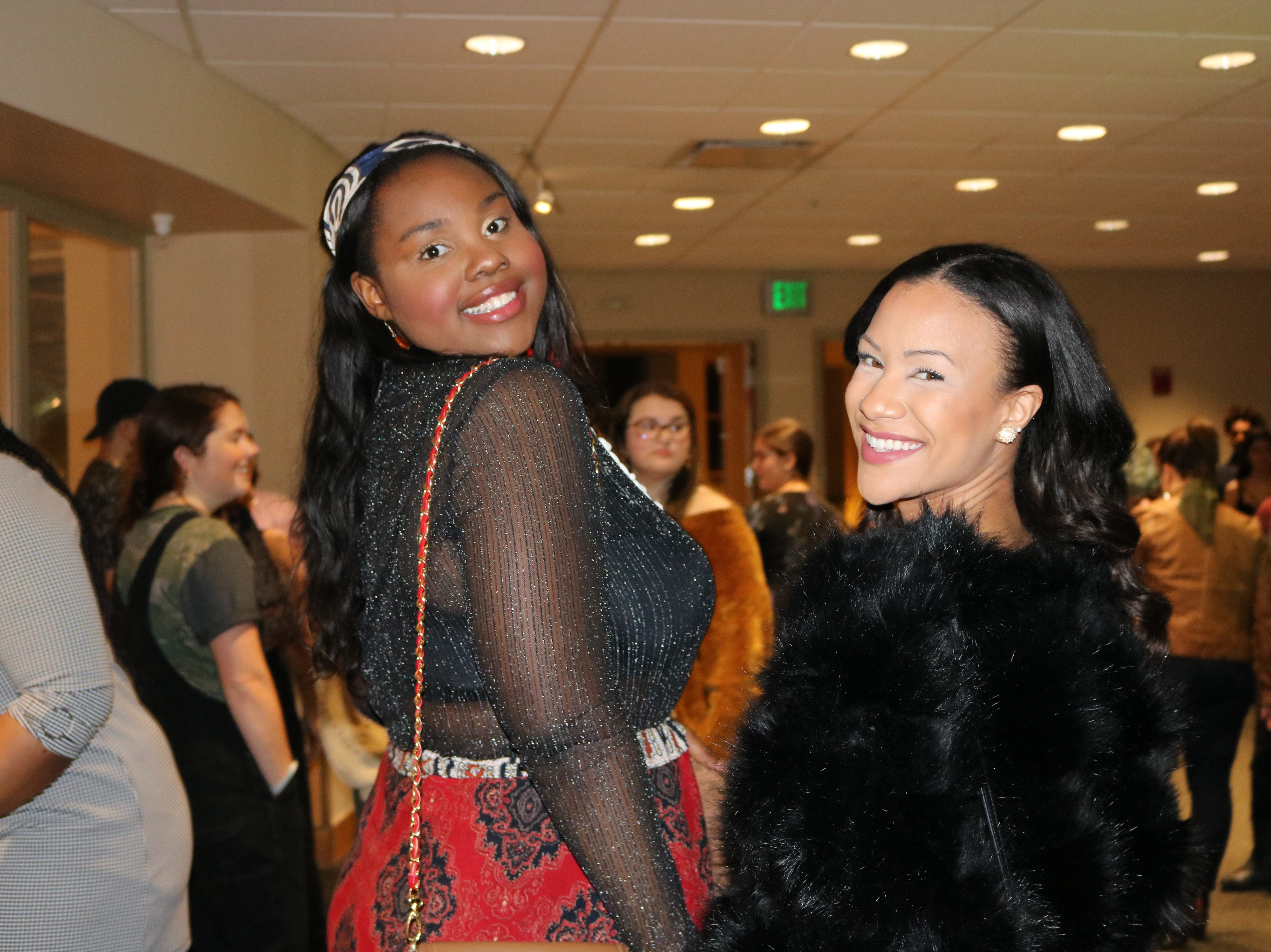 """UVM students Javana Clark and Gabrielle Benimadho loved the energy of the 2019 fashion show """"Paint it Black,"""" calling it a """"celebration of black beauty,"""" on a break from the catwalk at the Davis Center."""