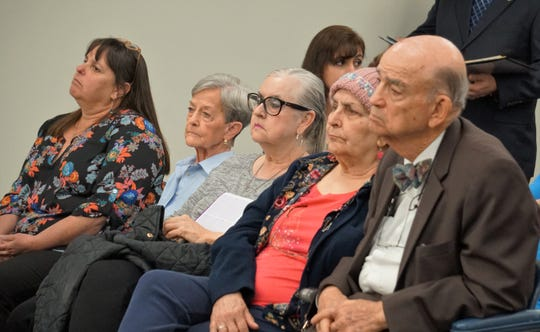Members of the audience speaking out in opposition to a proposal to tear down the 1914 Nueces County Courthouse attend a Feb. 25, 2019 meeting of the county commissioners court.