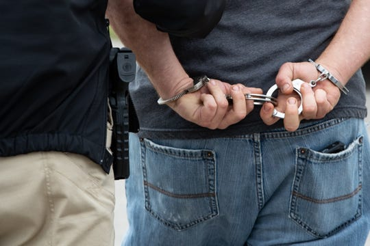 Corpus Christi City Marshal's Robert Rodriguez and Amanda Guerra take someone in to custody for an outstanding warrant in Flour Bluff during the City's warrant roundup on Monday, Feb. 25, 2019.