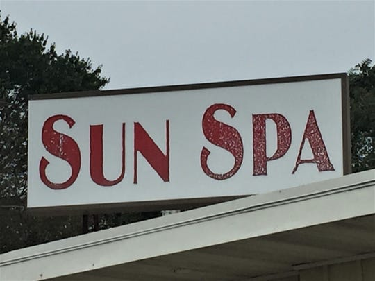 A weathered sign identifies Sun Spa on Route 38 in Southampton.