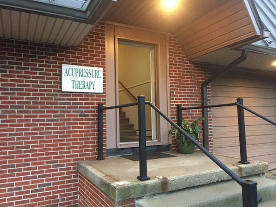 The Burlington County Prosecutor's Office wants to confiscate cash seized during a raid at Accupressure Therapy on Route 70 in Southampton.
