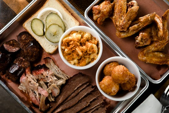 The Meat Plate at Station Family + BBQ as well as an order of their Smoked Chicken Wings with a side of Mac and Cheese and Fried Spoonbread.