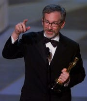 "Cincinnati-born director Steven Spielberg accepts the best director Oscar for ""Saving Private Ryan"" in 1999. He also won best director and as producer for best picture for the 1993 film ""Schindler's List."""