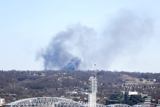 Cloud rises from a fire seen from downtown Cincinnati on Monday Feb. 25, 2019.