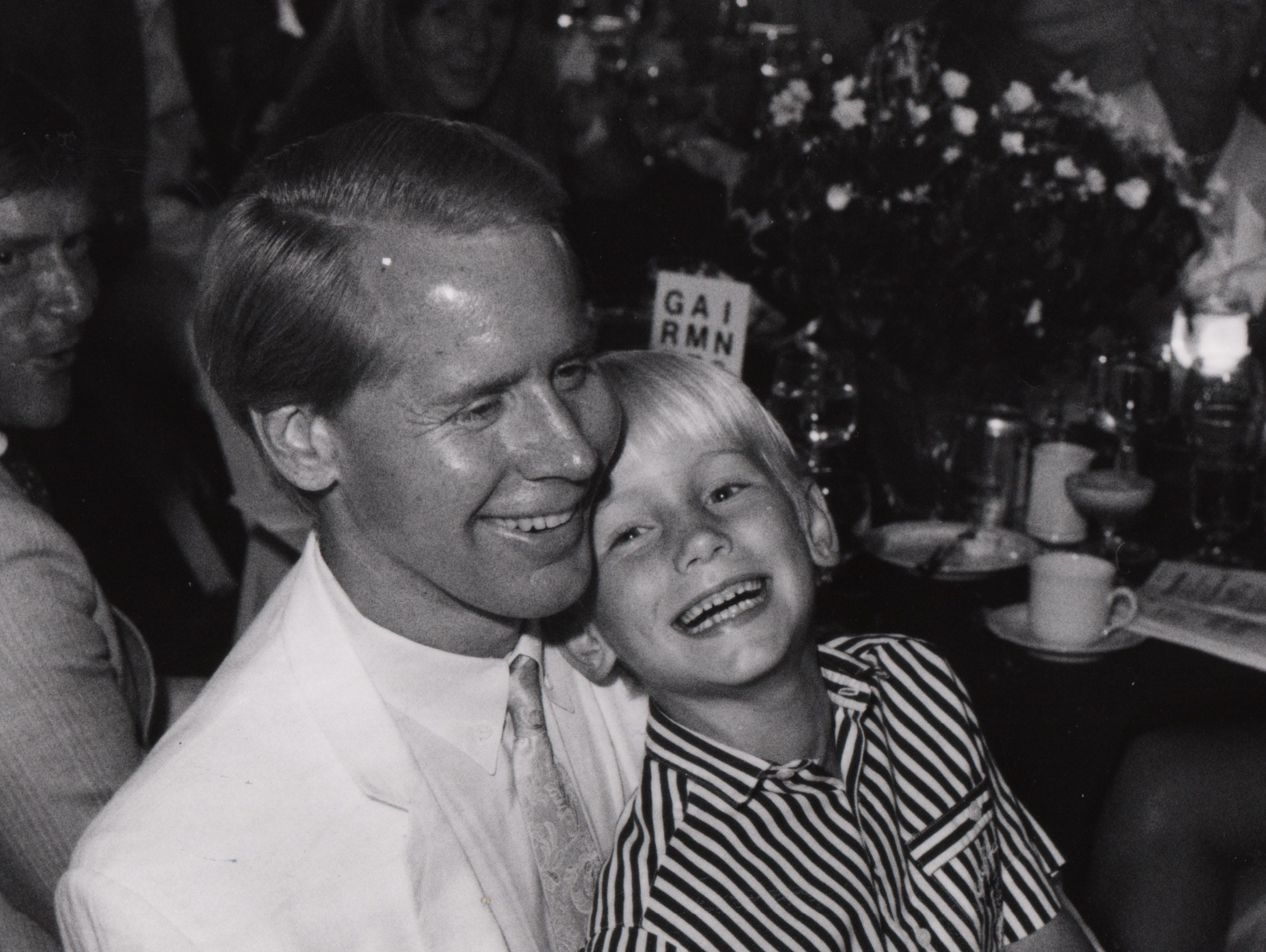 Carl Lindner III enjoys a laugh with his son Carl Lindner IV at the American Jumping Classic in 1990.