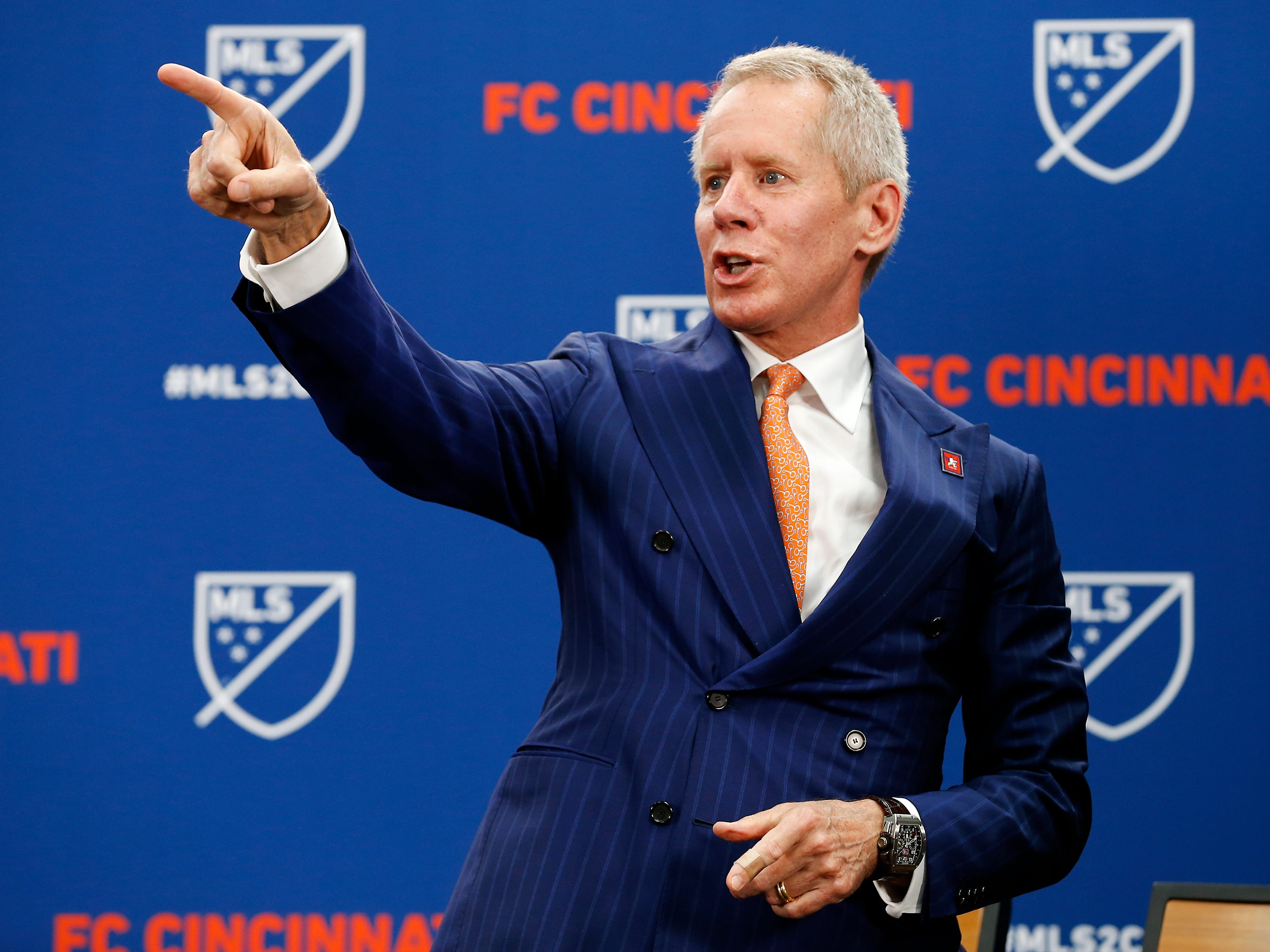 Majority owner Carl Lindner III points to the crowd as he thanks them at Rhinegeist Brewery in the Over-the-Rhine neighborhood of Cincinnati on Tuesday, May 29, 2018. FC Cincinnati was announced as the newest expansion team to join Major League Soccer.