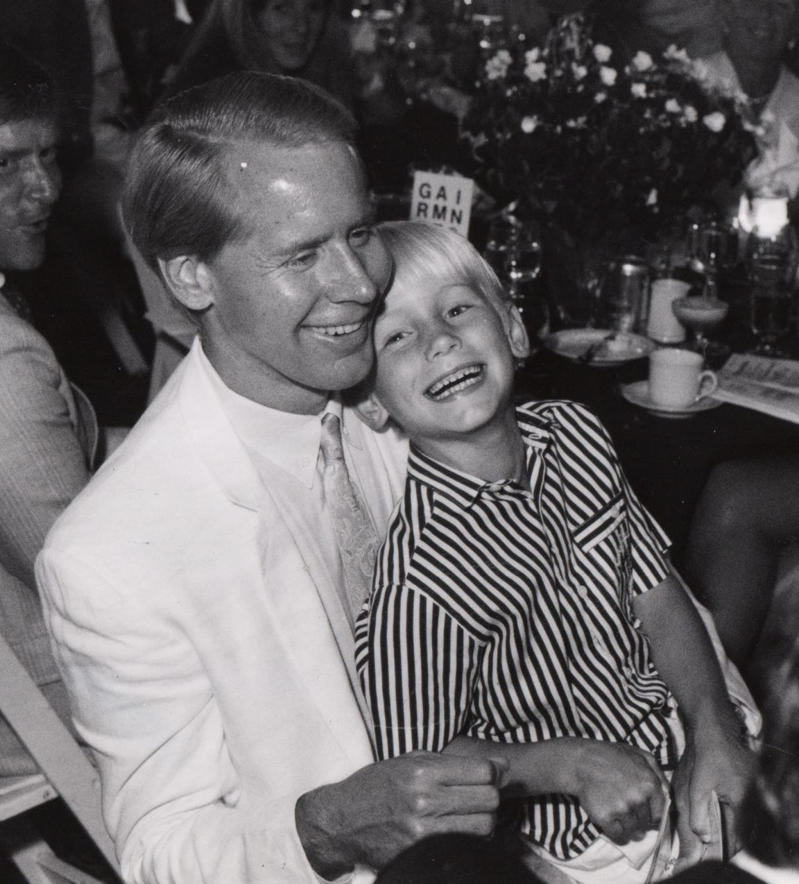 Lindner enjoys a laugh with his son, Carl Lindner IV, in 1990.
