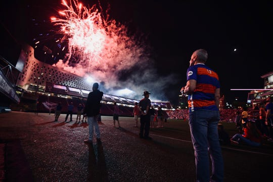 Carl Lindner III watches the post game fireworks Saturday, August 18th at Nippert Stadium
