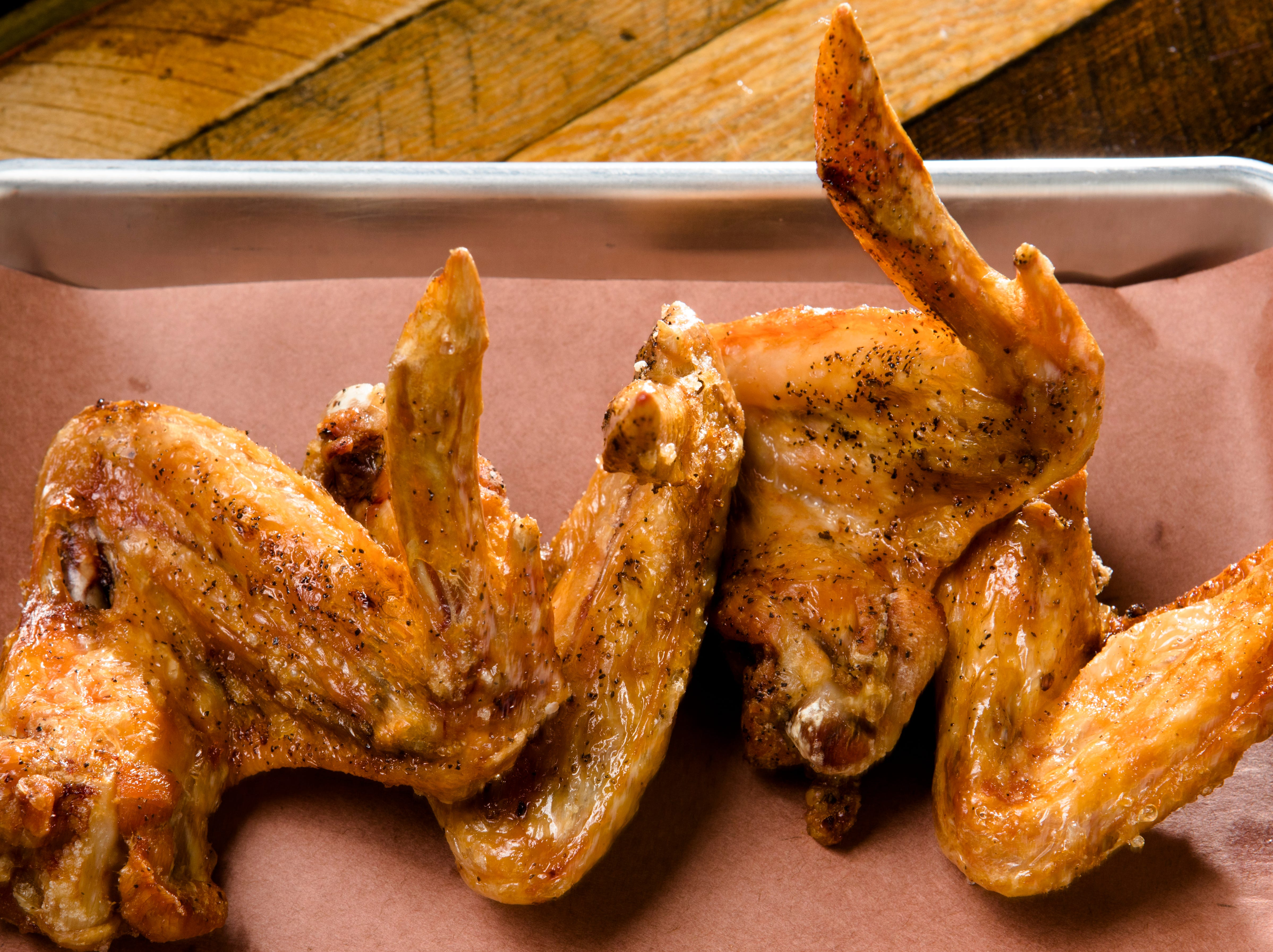 Station Family + BBQ's Smoked Chicken Wings are full wings smoked with salt and pepper and then flash fried to order.