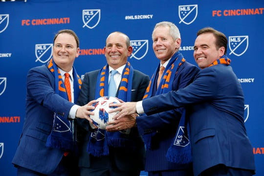 From left, FC Cincinnati president Jeff Berding, MLS commissioner Don Garber, team owner Carl Lindner III and Mayor John Cranley pose at the conclusion of the event at Rhinegeist Brewery on May 29, the day FC Cincinnati was announced as the newest expansion team to join Major League Soccer.