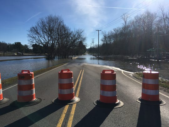 Dunbar Cave Road, shown at the intersection with Idaho Springs Road, remained closed for flooding on Monday morning, Feb. 25, 2019.