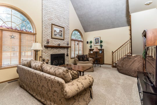 Situated on a lot measuring just under an acre, a 4,100 square-foot brick front Colonial is for sale in Clinton Township for $639,900.