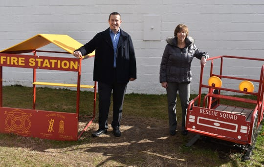 Jon Letko from Global Healthcare Management, Inc. and Sharon Klamik, director of the Milford YMCA Preschool.