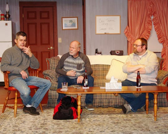 """Jeff Wherley, Denny Blanford and Leonard Hayhurst rehearse a scene from """"Beer for Breakfast"""" opening Friday at the Triple Locks Theater. The comedy also features Cyndi Shutt and is directed by Kathy Reid. The story revolves around three old college friends on a guy's weekend, which is interrupted by the wife of a fourth friend and a battle of the sexes ensues."""