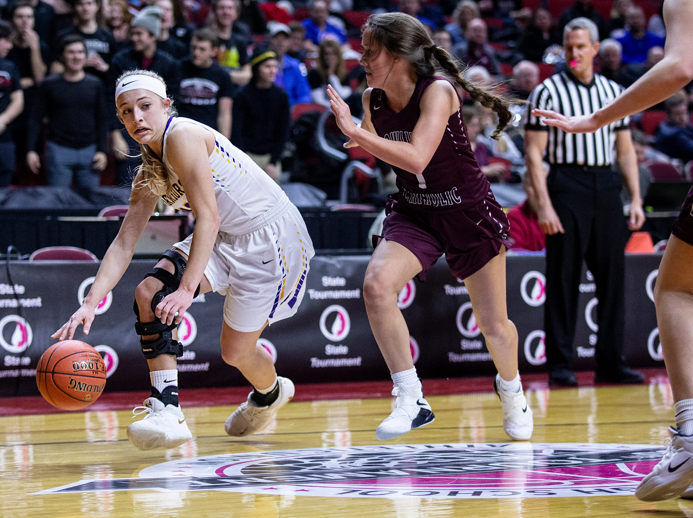 Waukee's Katie Dinnebier looks for a teammate to pass to during the Class 5A Iowa girls' state basketball tournament quarterfinal between Dowling Catholic and Waukee on Monday, Feb. 25, 2019, in Wells Fargo Arena.